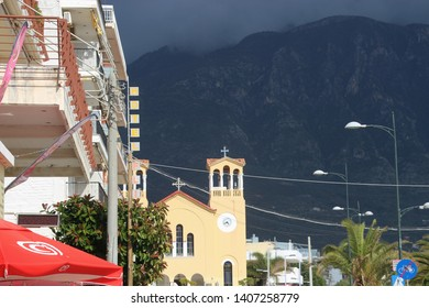 Kalamata, Peloponnese, Greece - April 9, 2019: Street buildings in Kalamata, next to the sea. An orthodox church in the background. South-east Europe.