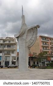Kalamata, Peloponnese, Greece - April 9, 2019: Plaster sculpture on a city square in Kalamata.  Peloponnese, Greece, South-east Europe.