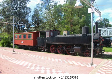Kalamata, Peloponnese, Greece - April 9, 2019: Historic locomotive and railway cars in the Kalamata Municipal Railway Park. Objects dating from 1885 till 1947. Open-air museum with free entry, complet