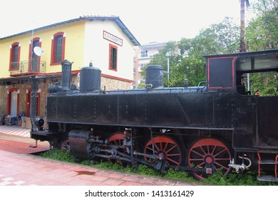 Kalamata, Peloponnese, Greece - April 9, 2019: Historic locomotive and railway stat in the Kalamata Municipal Railway Park. Open-air museum with free entry, Objects dating from 1885 till 1947. Europe.