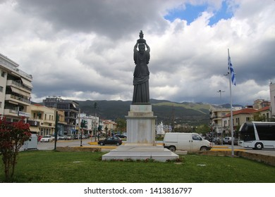 Kalamata, Peloponnese, Greece - April 9, 2019: Sculpture located at the end of the Railway Park, downtown Kalamata. Cityscape view.  South-east Europe.
