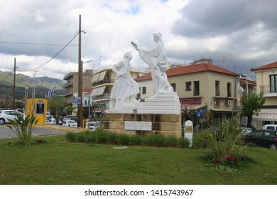 Kalamata, Peloponnese, Greece - April 9, 2019: White plaster statue in the center or Kalamata.  Cityscape view. South-east Europe.