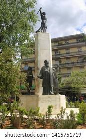 Kalamata, Peloponnese, Greece - April 9, 2019: Bronze sculpture showing three historic figures, situated in Kalamata center.  South-east Europe.