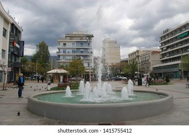 Kalamata, Peloponnese, Greece - April 9, 2019: Square with fountain in the pedestrian area of Kalamata. South-east Europe.