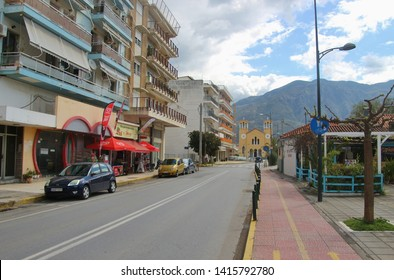 Kalamata, Peloponnese, Greece - April 9, 2019: Street buildings, shops and bars in Kalamata, next to the sea. South-east Europe.