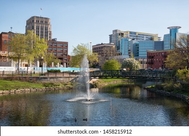 Kalamazoo, Michigan - May 14, 2019: Skyline view of Kalamazoo, Michigan as seen over the fountain from Arcadia Creek.
