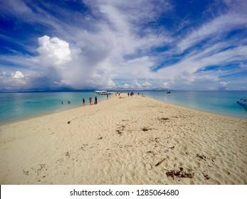 Kalanggaman Island Sandbar surrounded by beautiful, clear water and blue skies.