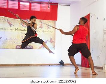 Kalari senior artists jump and have a spear fight together at the 'Parashurama Vallabhatta Kalari Academy event' held on October 19,2018 at the Prajna Ranga Hall,Bengaluru