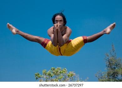 Kalari warrior jumping. Kalarippayat, indian ancient martial art of Kerala
