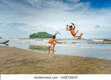 Kalaripayattu -Artists performing Kerala's oldest traditional martial art form on a beach in Kerala, India