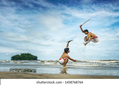 Kalaripayattu -Artists performing Kerala's oldest traditional martial art form on a beach in Kerala, India