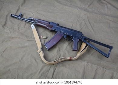 Kalashnikov AK 47 With Ammunitions On Canvas Background