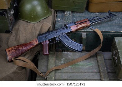 Kalashnikov AK 47 with ammunitions on army green box background