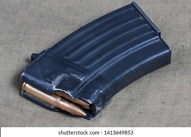 kalashnikov ak gun magazin with 7,62 mm ammo on canvas background