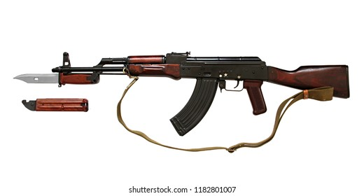 Kalashnikov AK gun with tactical knife of special forces isolated on white background.