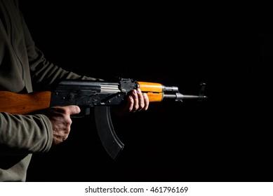 Kalashnikov assault rifle close-up in the dark