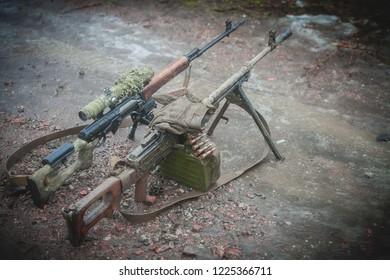 Kalashnikov machine gun and Dragunov sniper rifle on military firing