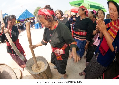 KALASIN,THAILAND-MARCH 9 : Unidentified minority senior woman competitive pounding rice fun and happiness in The 2nd International Phutai Festival on March 9,2013 in Kalasin Province,Thailand.