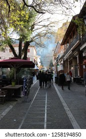 Kalavryta, Achaea / Greece - 12/02/2018: People and tourists are walking  at the pedestrian area at center of Kalavrita city near the square and odontotos train station at winter