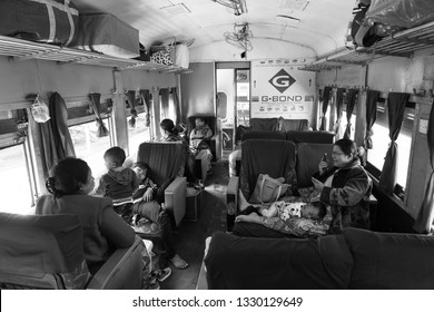 KALAW, MYANMAR - 23 NOVEMBER, 2018: Black and white picture inside burmese traditional trains with local people in Kalaw, Myanmar