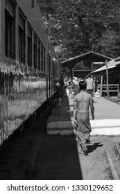 KALAW, MYANMAR - 23 NOVEMBER, 2018: Black and white picture of local burmese people at the train platform in Kalaw, Myanmar