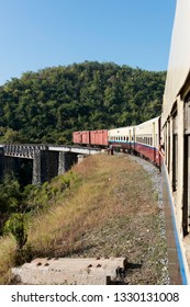 KALAW, MYANMAR - 23 NOVEMBER, 2018: Vertical picture of local train over an old Brigde in Kalaw, Myanmar