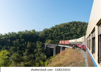 KALAW, MYANMAR - 23 NOVEMBER, 2018: Wide angle picture of local train over an old Brigde in Kalaw, Myanmar