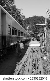 KALAW, MYANMAR - 23 NOVEMBER, 2018: Black and white picture of local burmese traditional train at the train platform in Kalaw, Myanmar