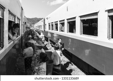 KALAW, MYANMAR - 23 NOVEMBER, 2018: Black and white picture of traditional burmese people in their daily life on the railway in Kalaw, Myanmar