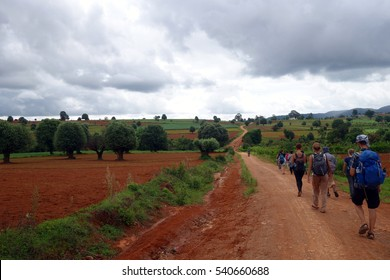 KALAW, MYANMAR - JUNE 30, 2016: Unidentified group of hiker travelers does a trekking from kalaw to inle lake.