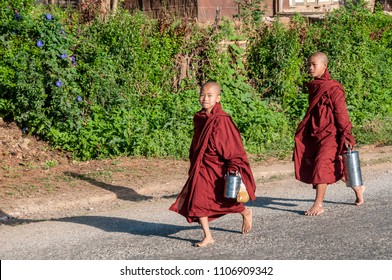 KALAW, MYANMAR - NOV 8, 2012: young Buddhist monks return to the monastery of Kalaw after the morning round for the collection of offers, in Kalaw on November 8, 2012.