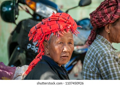 KALAW, MYANMAR - NOV 8, 2012 : at the Kalaw market an ethnic woman Pao wears the characteristic colorful turban, in Kalaw on November 8, 2012.
