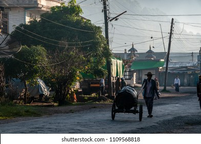 KALAW, MYANMAR - NOV 8, 2012 : the streets of Kalaw early in the morning are populated by people who start the market in Kalaw on November 8, 2012. The morning fog has not yet thinned out.