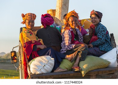 KALAW, MYANMAR - NOVEMBER 28, 2014: many peasants in Burmese traditional clothes come home in the evening after a day's work on the fields near Kalaw