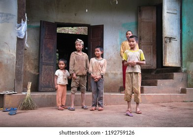 KALAW/MYANMAR - SEP 17. Unidentified local children pose for a photo in the yard of their home on September 17, 2018 in small village near Kalaw, Shan State, Myanmar (Burma), Southeast Asia