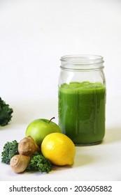 Kale apple lemon ginger juice vertical