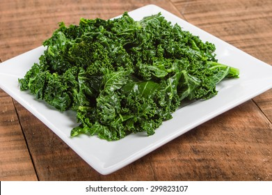 Kale greens on white plate ready to serve