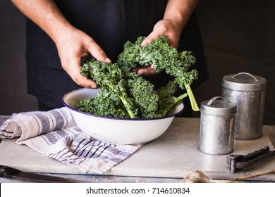 Kale leafy greens vegetable box hold in hands wash black wall raw kale ready to prepare food hand greens leafy