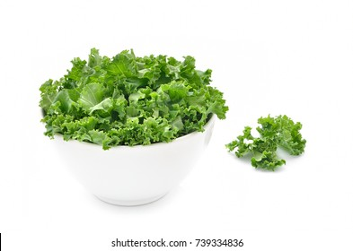 Kale leaves in a bowl isolated on white background