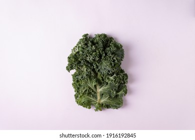 Kale on a white background. Horizontal orientation. View from above.