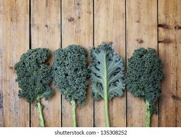 Kale super vegetable on a wooden background