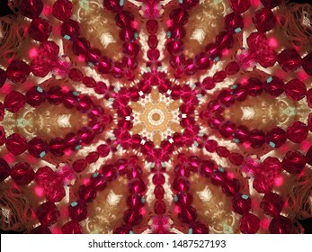 A kaleidoscope image of red sparkly beads and ecru lace. Looks a little like stained glass.