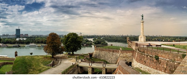 Kalemegdan fortress and Victor monument Belgrade, Usce Sava and Danube confluence view at cloudy spring day