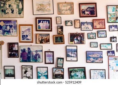 Kaleucagys, Kekova, Turkey, May 8, 2016: Many photos in the frames on a white wall