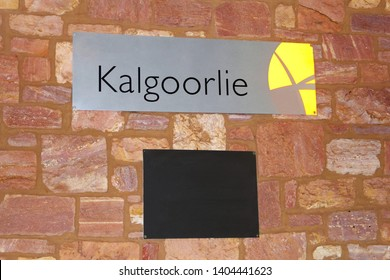 KALGOORLIE, NULLARBOR PLAIN, AUSTRALIA - November 12, 2015. Logo sign of Kalgoorlie railway station at stone building. Indian Pacific train stops at this station,connecting Perth, Adelaide and Sydney.