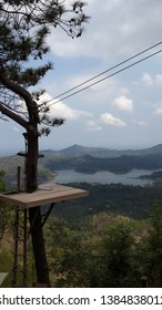 Kalibiru,beautiful tourism photo spot on tree with forest and lake at background