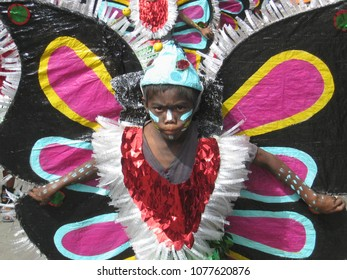 Kalibo, Aklan / Philippines - Jan 15 2006 : Ati Atihan Festival young child in multicolored butterfly costume