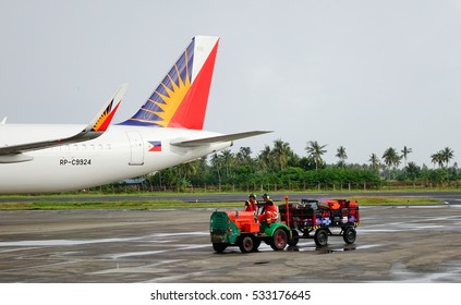 Kalibo, Philippines - Dec 16, 2015. Vehicles at the Kalibo International Airport in Kalibo, Philippines. Kalibo is the main transportation hub for the resort island of Boracay.