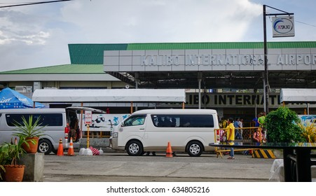 Kalibo, Philippines - Dec 16, 2015. Traffic on street near the Kalibo International Airport in Kalibo City, Philippines.