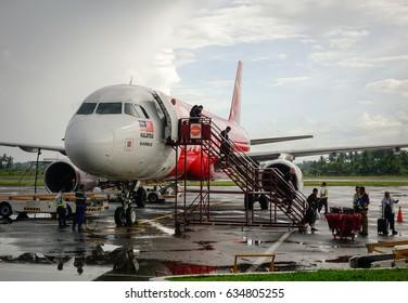 Kalibo, Philippines - Dec 16, 2015. An AirAsia airplane docking at Kalibo International Airport in Kalibo City, Philippines.
